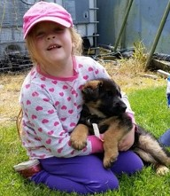 Girl Holding One of Our Puppies - Chinook, WA